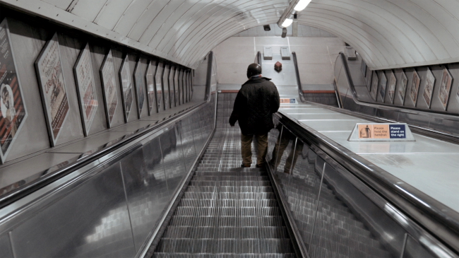 stop-ageism-loneliness-man-alone-escalators-london_resized1