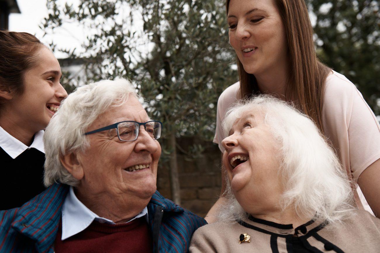 stop-ageism-older-couple-smiling-family-garden