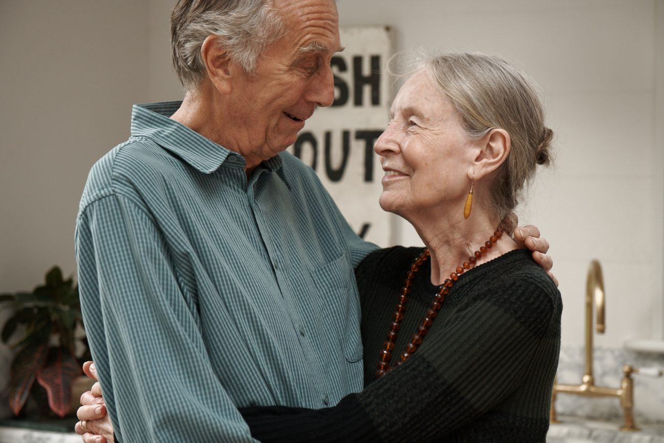 stop-ageism-couple-hugging-kitchen